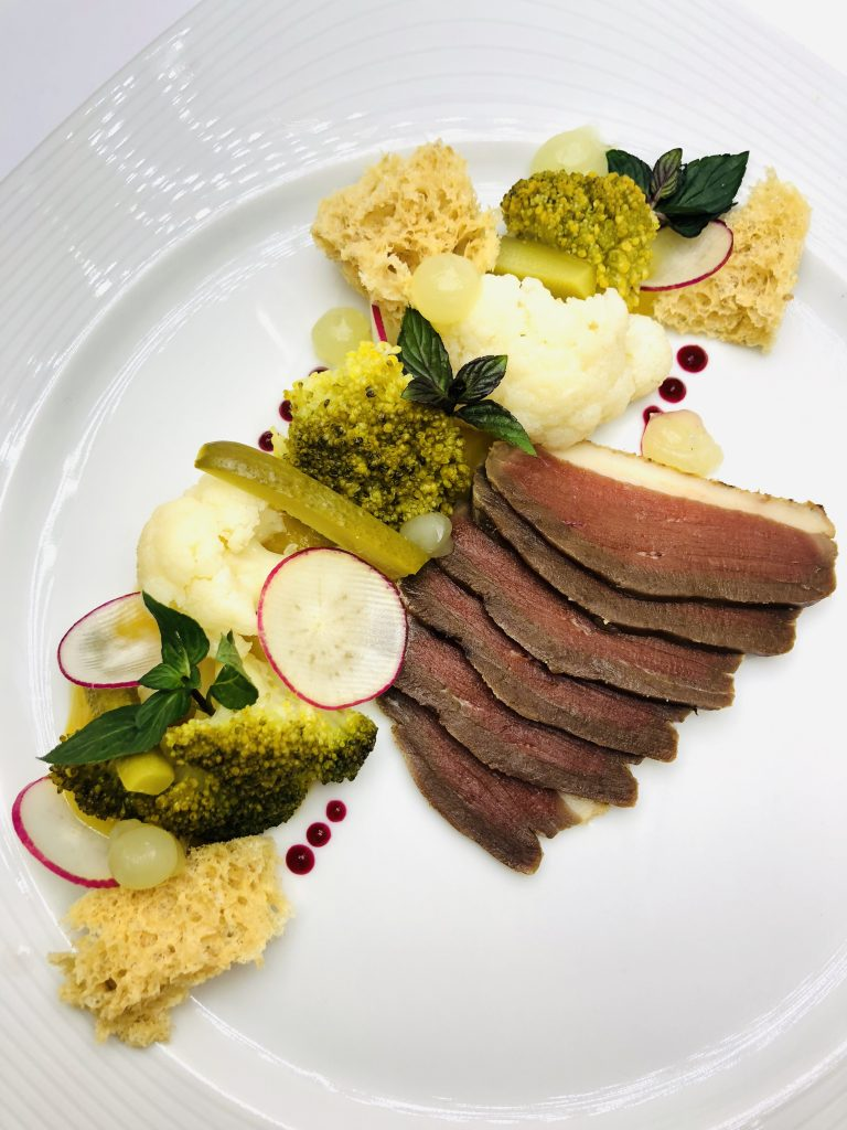 3. Homemade duck pastrami , garnished with aniseed pickle, peach cream and pear sponge.