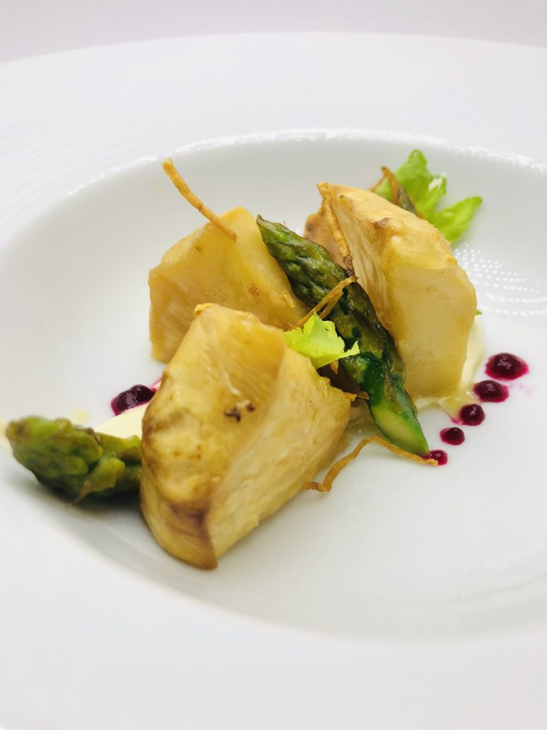 3. Celery steak, garnished with homemade mayonnaise with boletus and fresh asparagus.