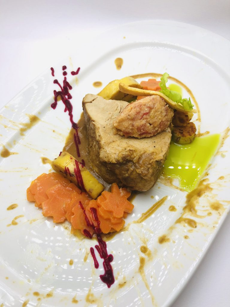 4. Slow cooked pork in a vacuum environment, garnish with roasted potatoes filled with smoked bacon, slowly roasted carrots and sauerkraut.