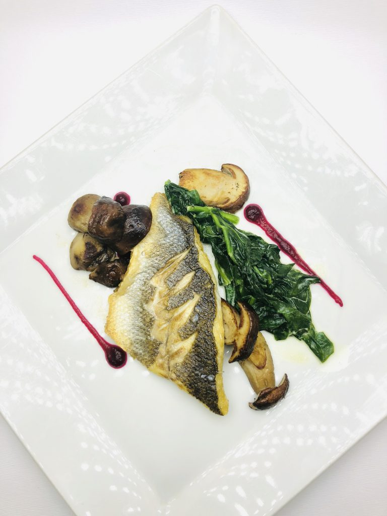 4. Wild sea bass fillet on fresh spinach and boletus mushrooms.