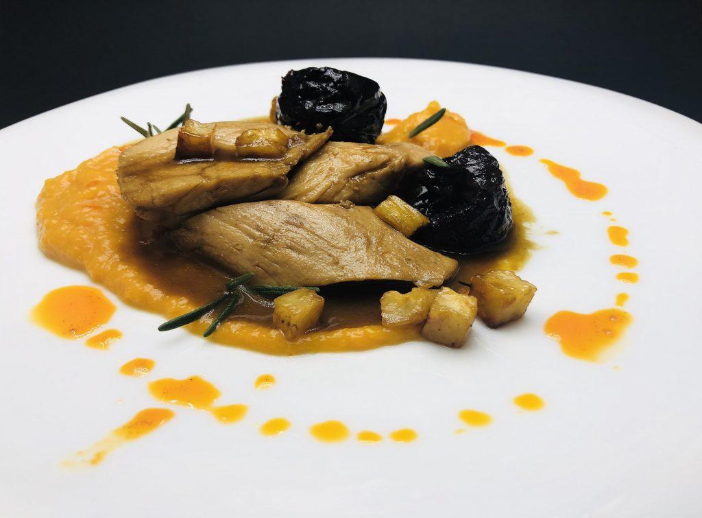 4. Pork tenderloin fillet with pumpkin puree, rehydrated prunes and marinated celery cubes.