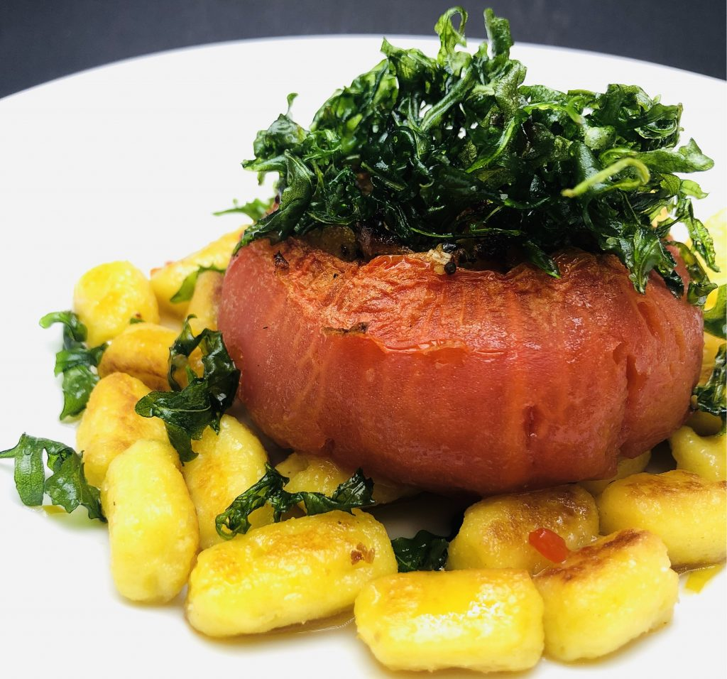 4. Potato Gnocchi, baked tomato stuffed with spelled crumbs and frills rucola.