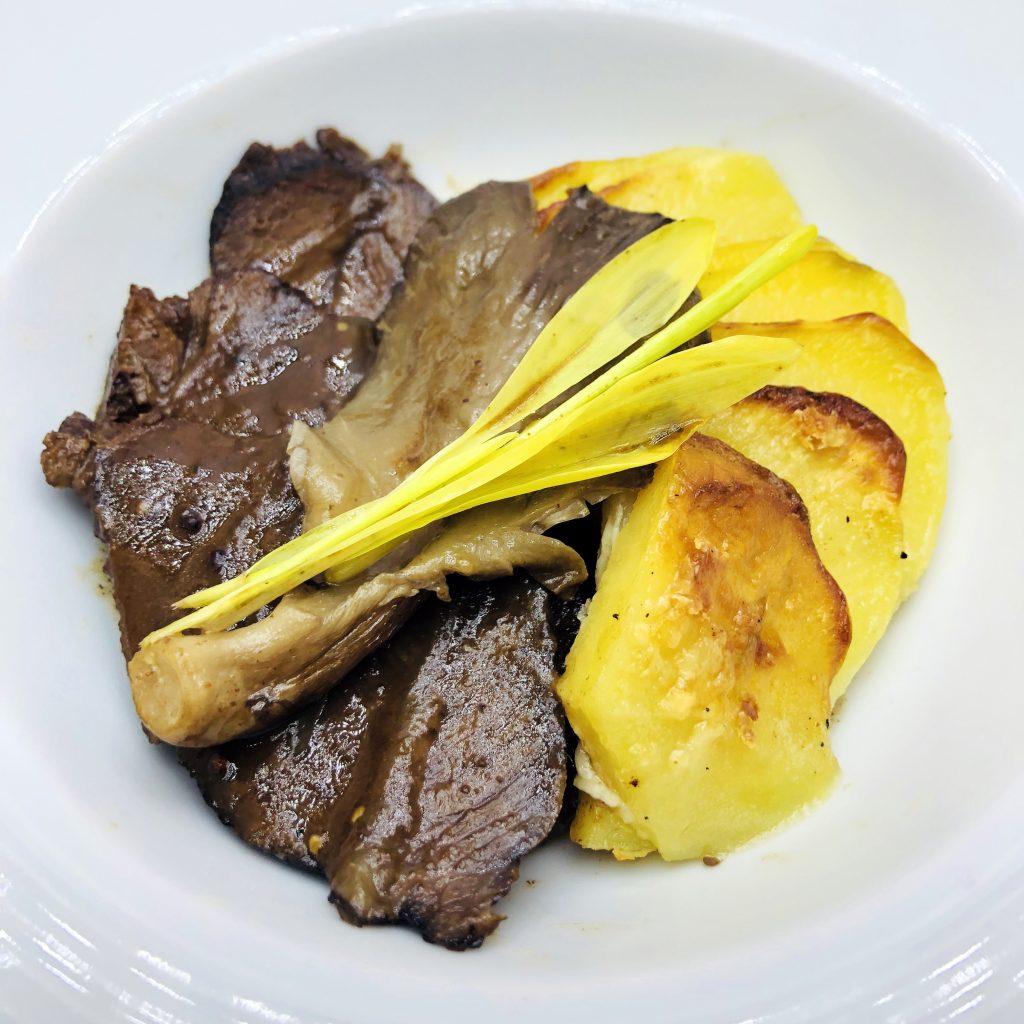 4. Braised beef cheeks garnished with potato gratin, mushrooms and rosemary