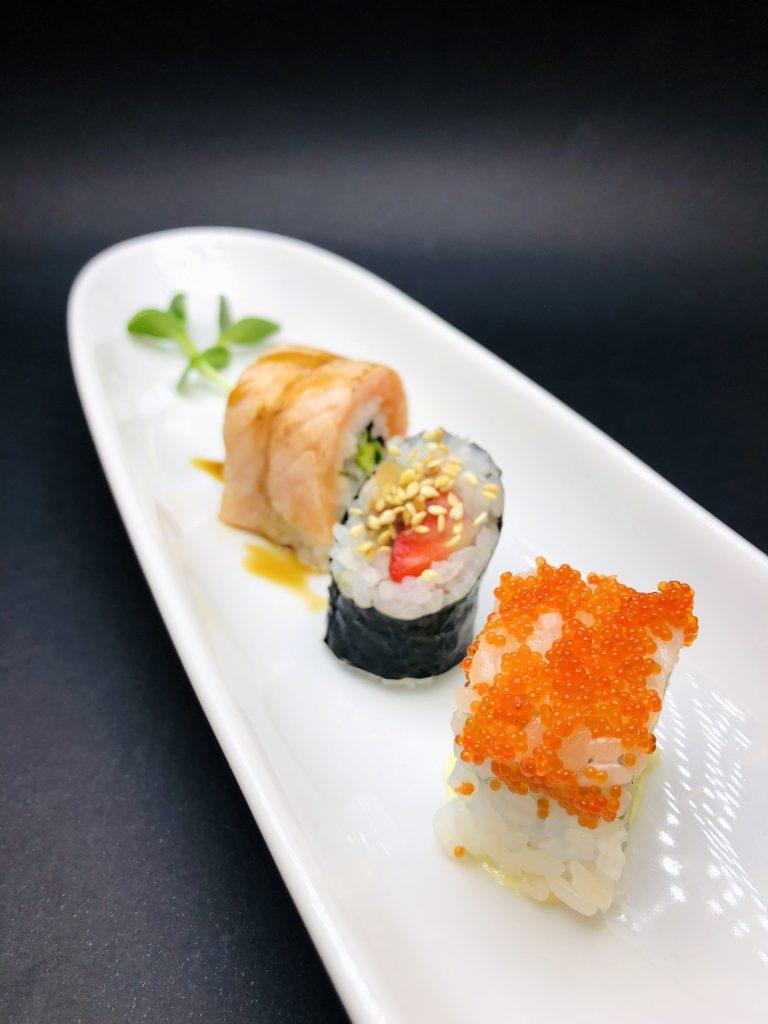 1. Tobiko caviar, Uramaki shrimp with cucumbers and Japanese mayonnaise; Hosomaki with smoked herring and strawberries; Uramaki salmon with teriyaki sauce, avocado and cucumber.