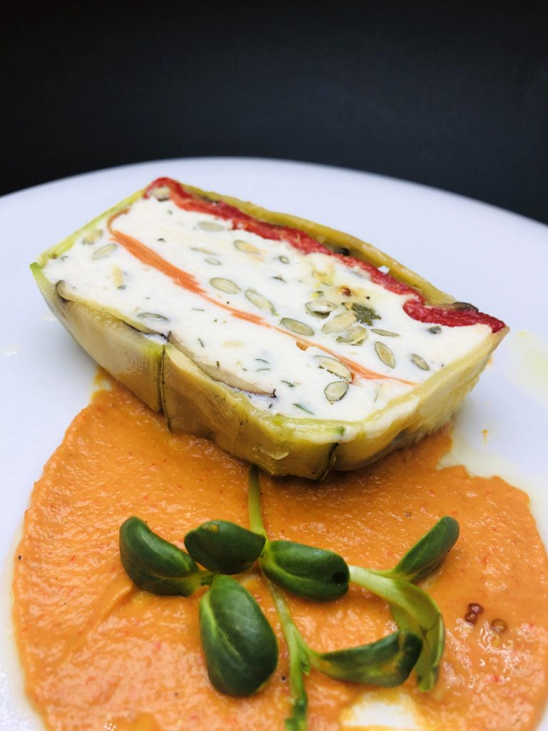 2. Vegetable terrine of zucchini, carrots and roasted red peppers in a boat with Pecorino Romano, ricotta and pumpkin seeds.