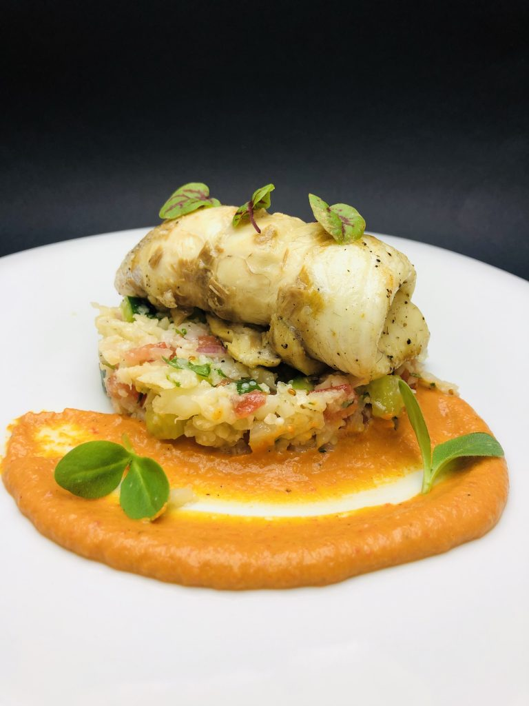 4. Rolled fillet from gilt-head bream on a bed of cauliflower tabouli and romesco sauce.