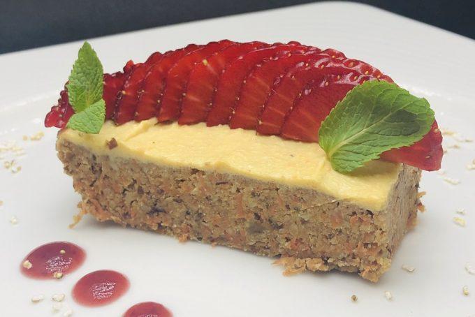 5. Raw cake from carrots, cashew, dates, raisins, coconut milk and coconut, cashew cream and fresh strawberries.