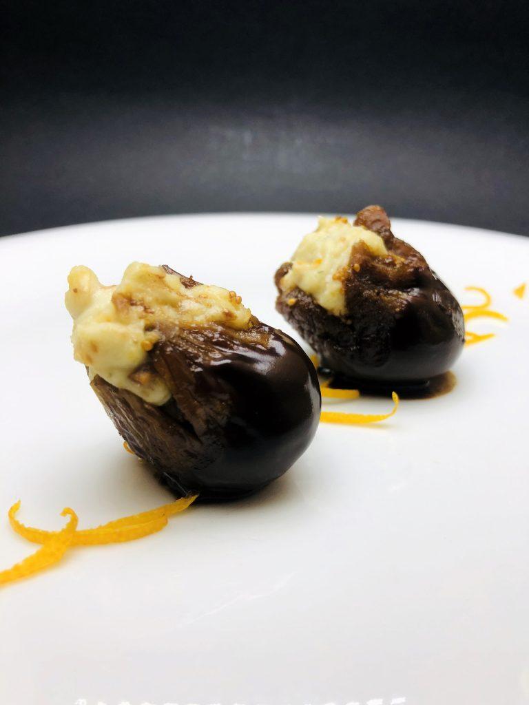 2. Bio-dried fig rehydrated in rum with cinnamon and vanilla, stuffed with gorgonzole, baked hazelnuts and orange peels, glazed in dark Italian chocolate
