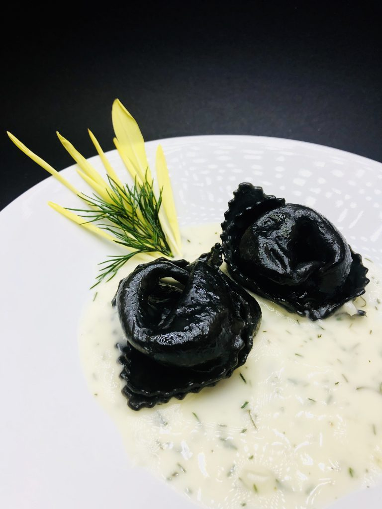 1. Agnolotti di sepia with bayonets mushrooms, salmon in fish Velouté with dill