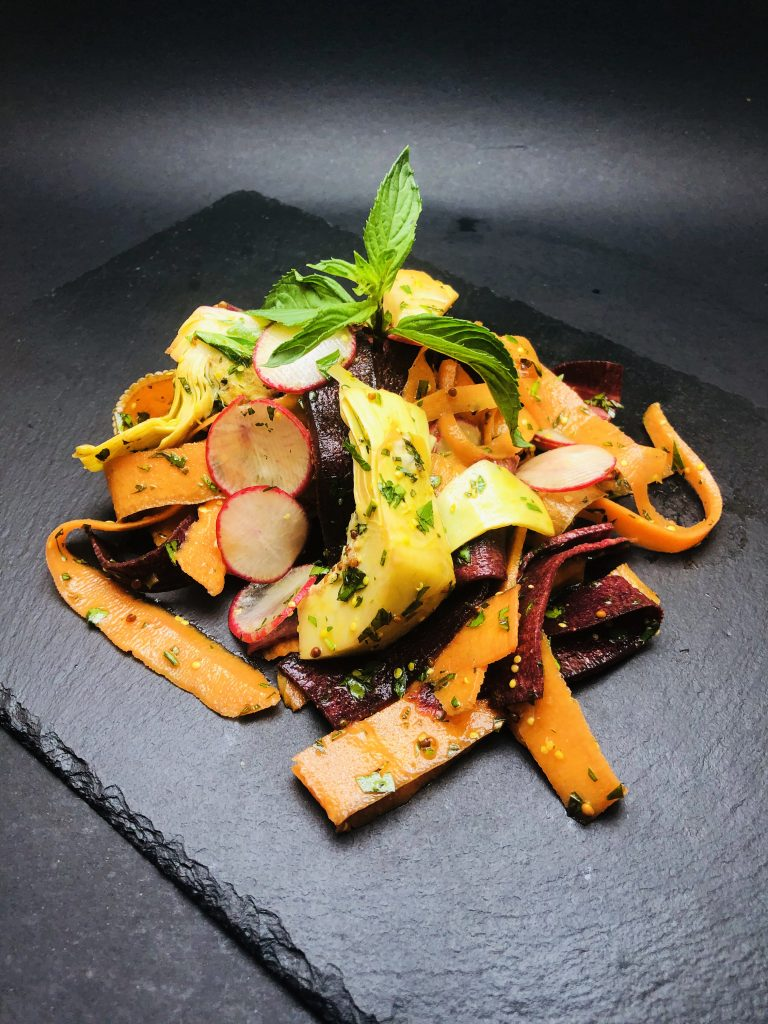 2. Salad with radishes, carrots, artichokes and purple carrot with mint dressing