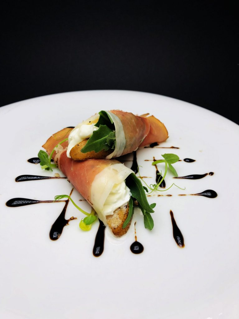 """1. Smoked German """"Black Forest"""" ham with sous-vide (poached) pears with cinnamon and nutmeg, fresh mozzarella and arugula."""