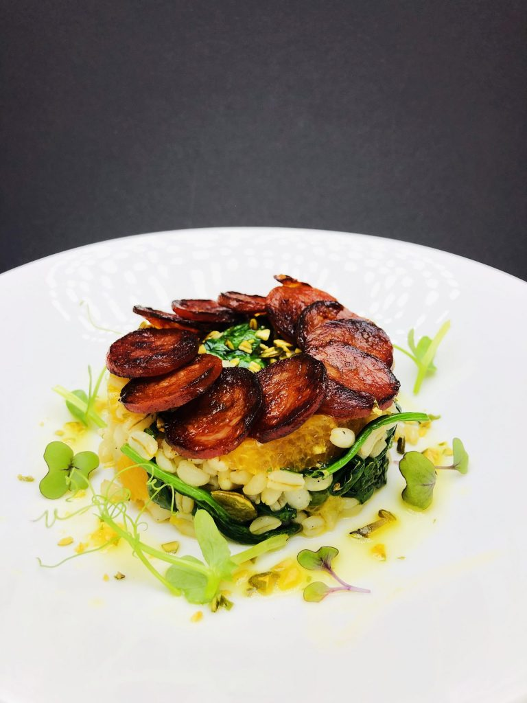 2. Barley salad with chorizo chips, baby spinach, orange fillets, citrus dressing and roasted pumpkin seeds.