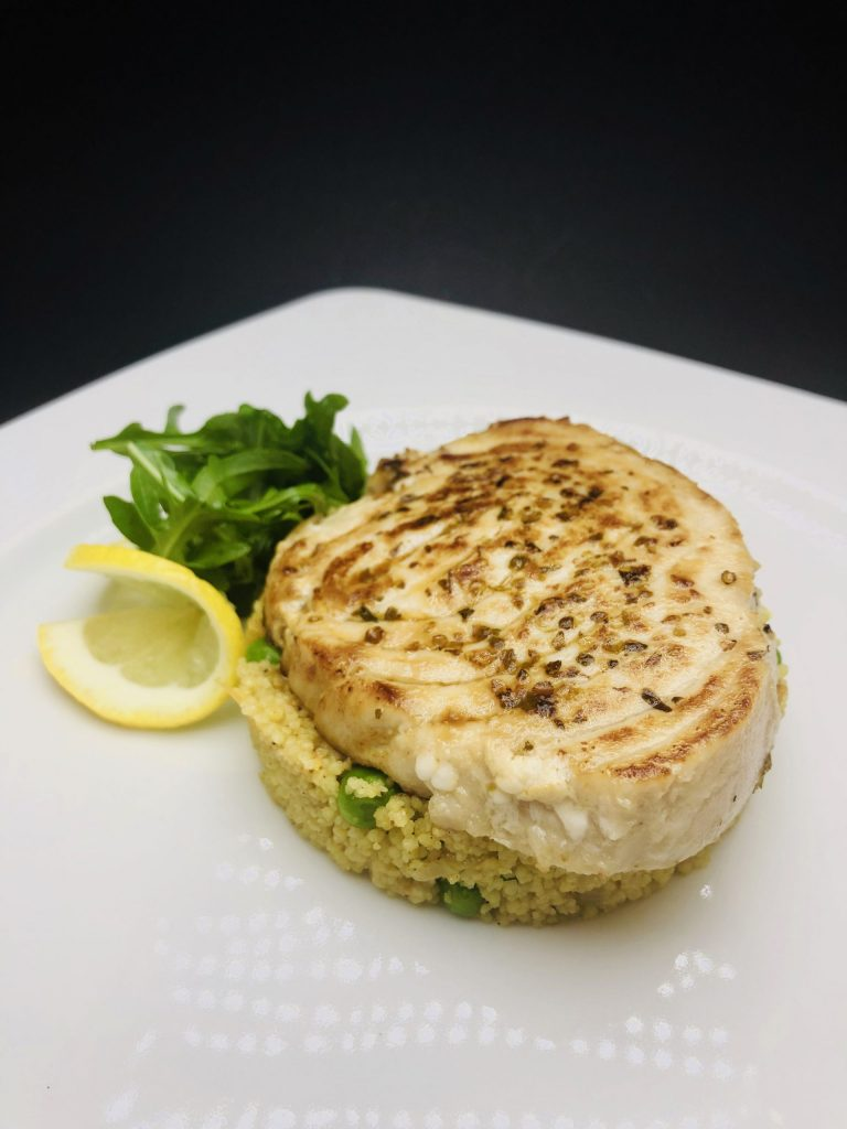 4. Baked marlin fish fillet flavored with a bouquet of Italian spices, combined with Moroccan couscous and fresh vegetables.