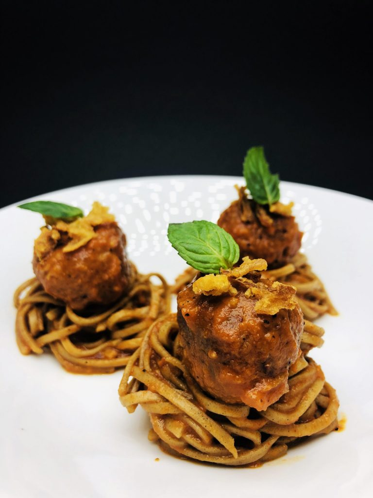 4. Black bean meatballs on soba noodles (from buckwheat), marinara sauce, fresh mint and crispy dehydrated onion.