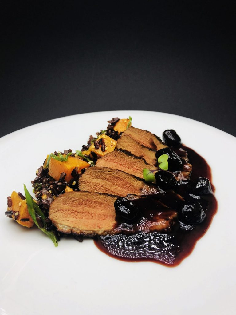 4. Duck magret with crispy skin, cleverly combined with imperial black rice, pumpkin and cherry sauce.