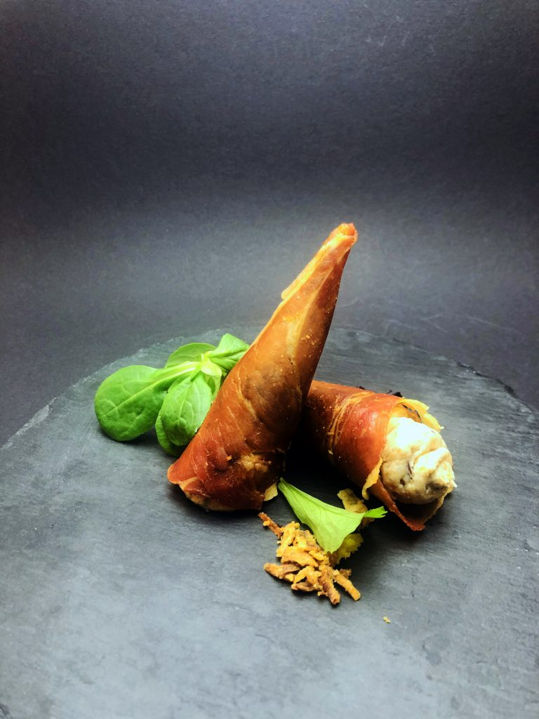 1. Crispy baked cones of Italian prosciutto, stuffed with cream cheese, dates, walnuts and fried onions.