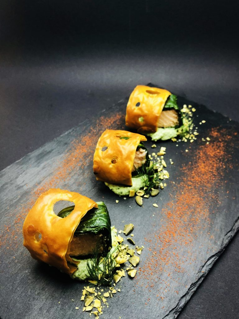 1. Smoked salmon fillet in baby spinach with grated lime peel, served with dill cream, fresh cheese and crispy pastry.