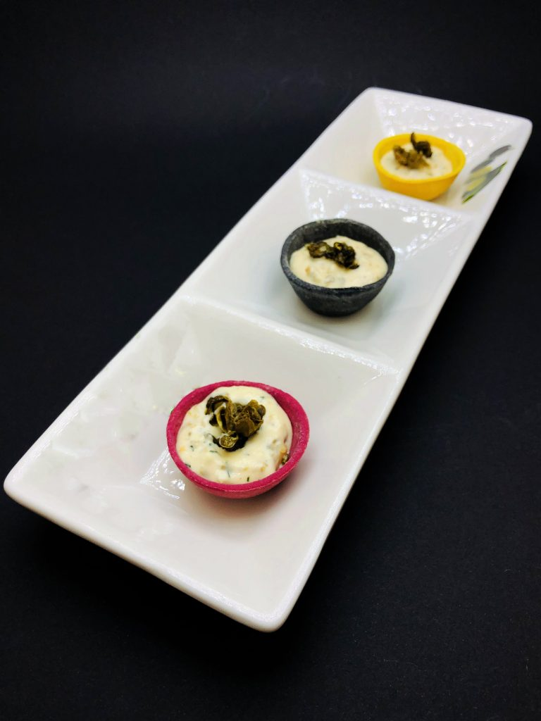 1. Tartlets of beetroot, turmeric and charcoal stuffed with homemade mayonnaise mousse, roasted capers and three types of smoked fish.
