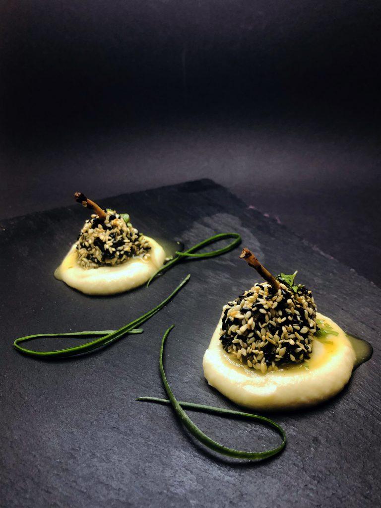 2. Frog leg drumsticks in white and black sesame crust, on celery muselin.