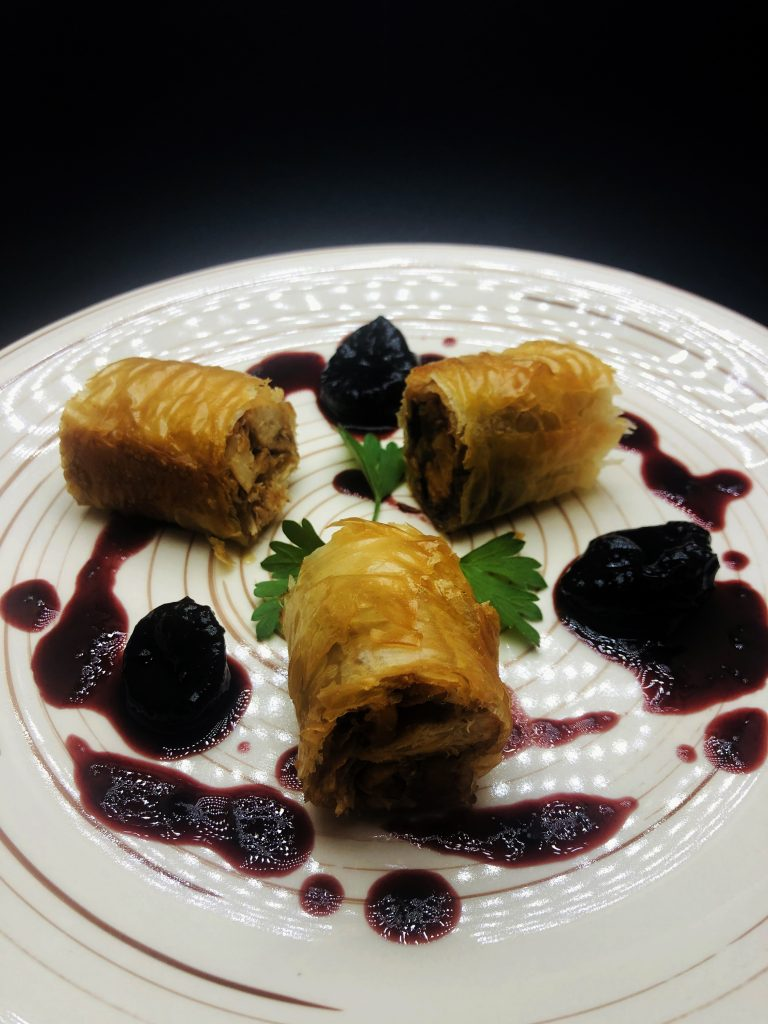 2. Rolled and deboned rabbit legs in crispy homemade pastry with prune sauce and merlot.