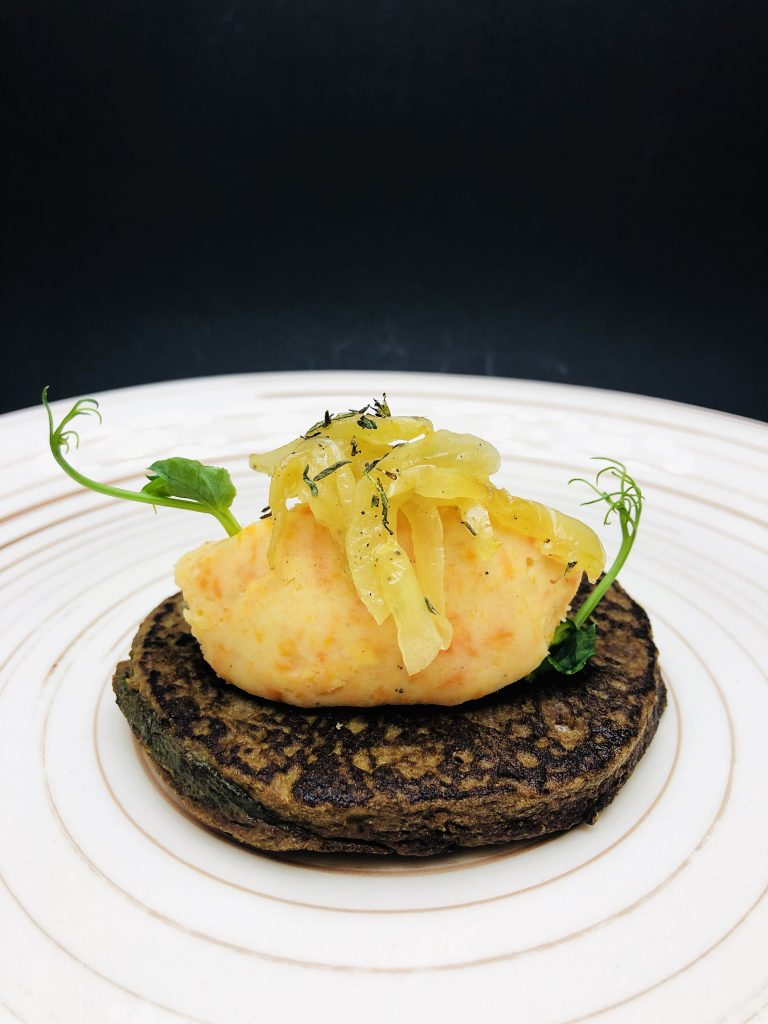 2. Veal liver pancakes garnished with aromatic puree and caramelized onions.