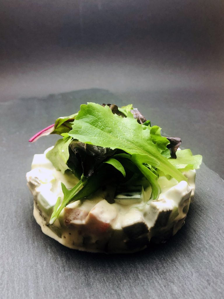 3. Salad with ground apple, cucumber, tomato, celery, marinated veal tongue and fine mayonnaise.