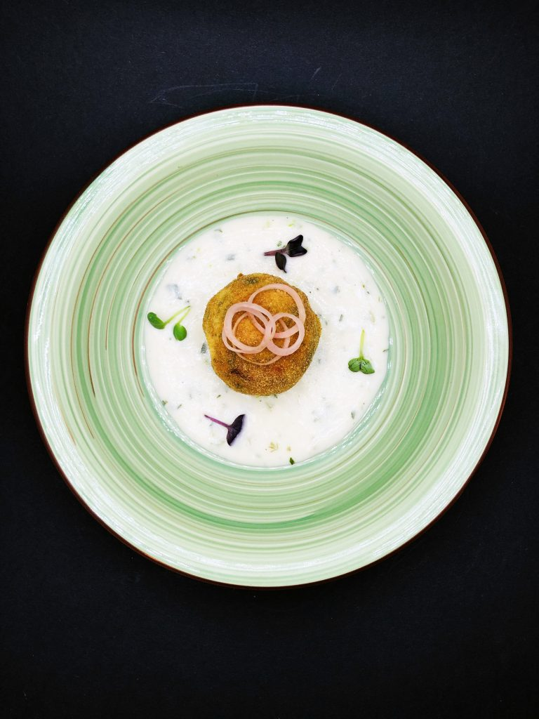 3. Fish meatball from white fish with a liquid center of ripe cheddar in a fish veloute with fennel.