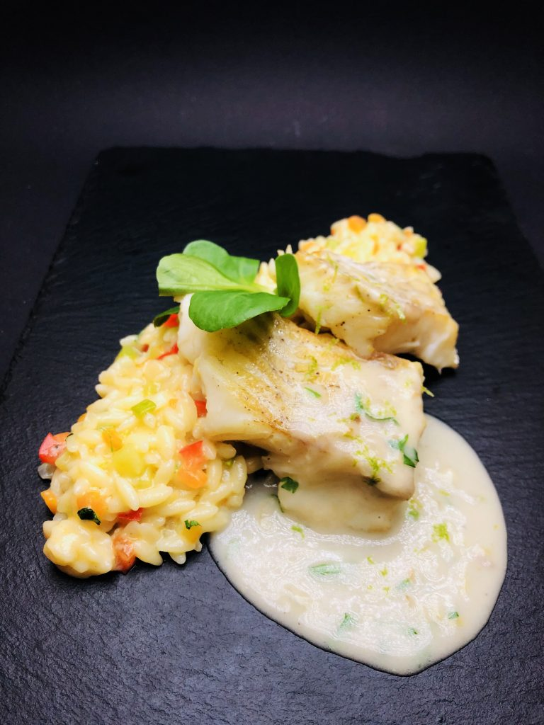 4. Roasted coconut cod in combination with vegetable risotto with orzo pasta, zucchini, yellow and red peppers.