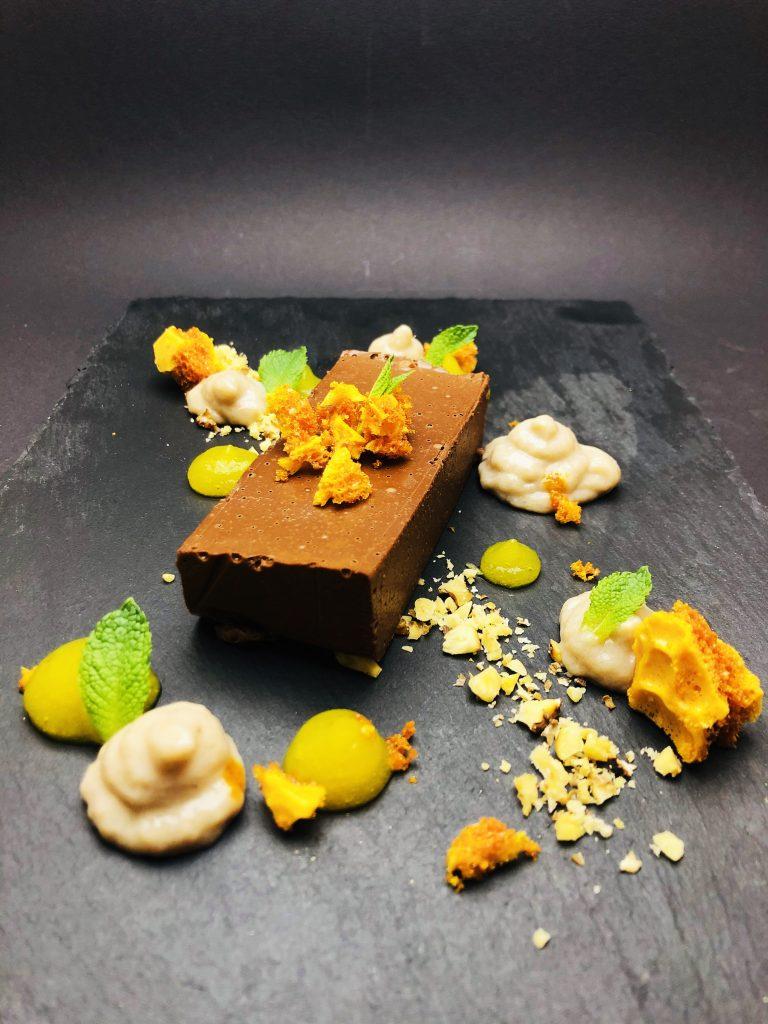 5. Dark chocolate delays with banana cream, mango gel, agave honeycomb and cane sugar.