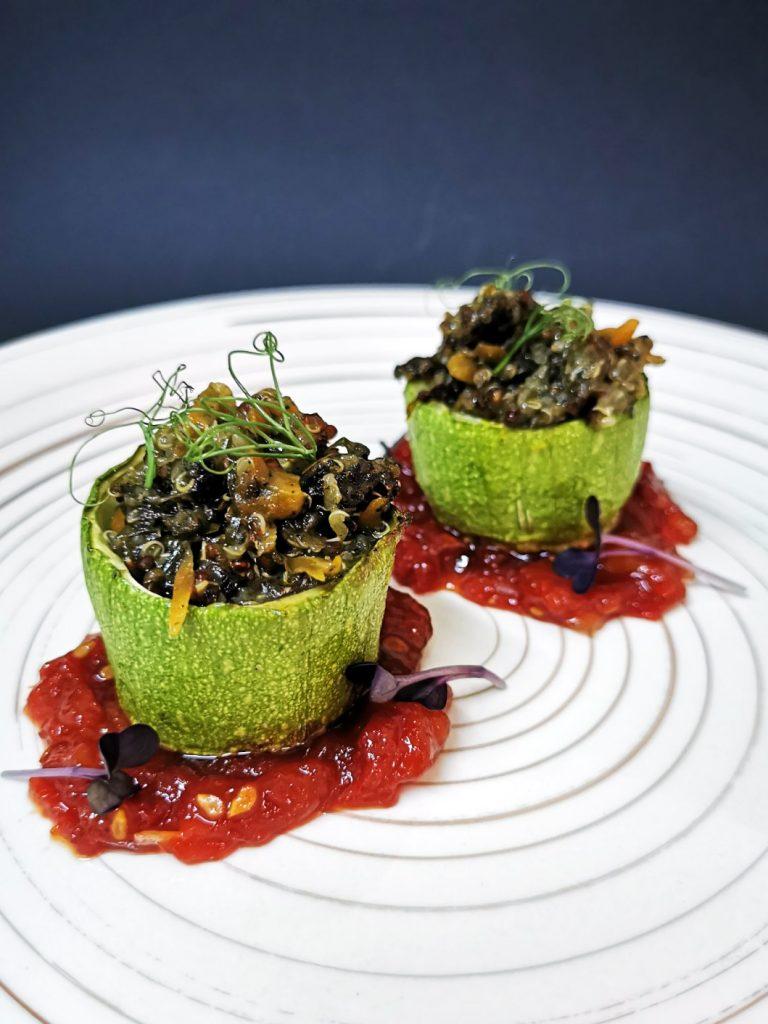 1. Stuffed zucchini stumps with red quinoa, nettle cream and vegan cheese, served on tomato jam.