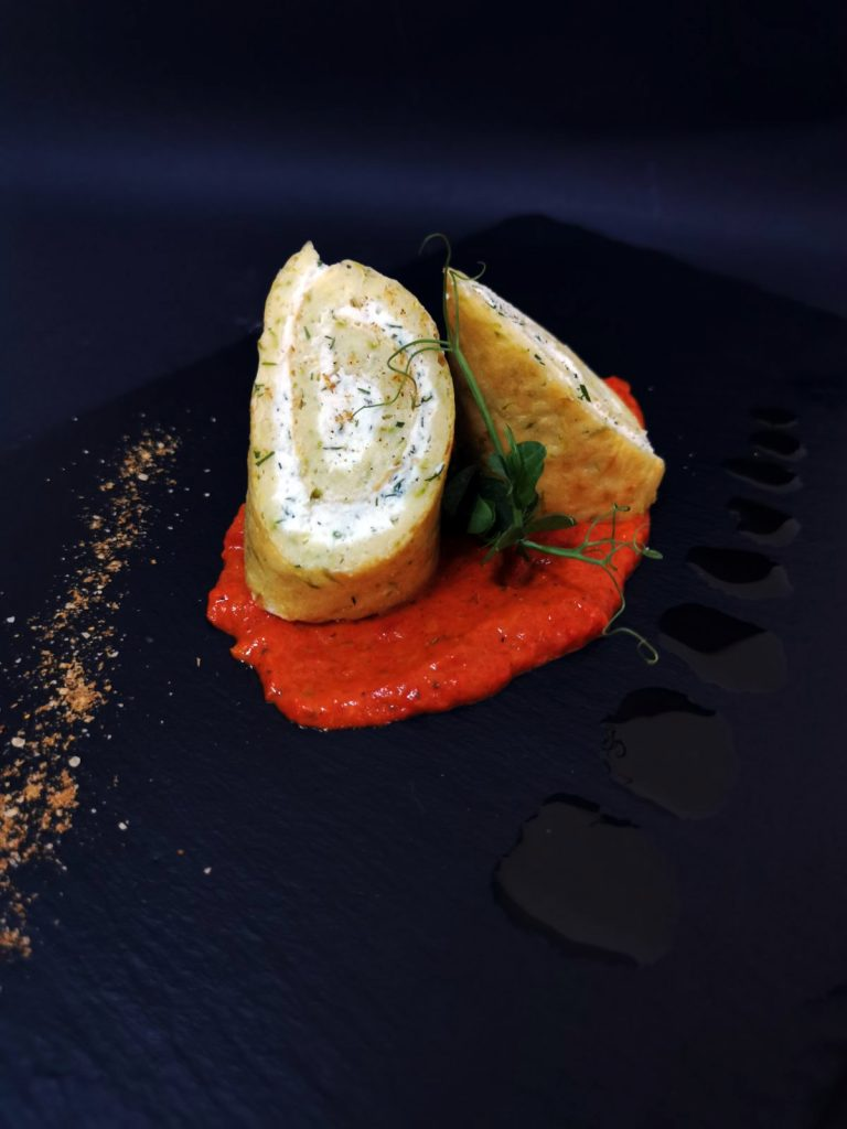 1. Zucchini roll with herbal cream cheese, roasted pepper mousse and a pinch of colored salt.