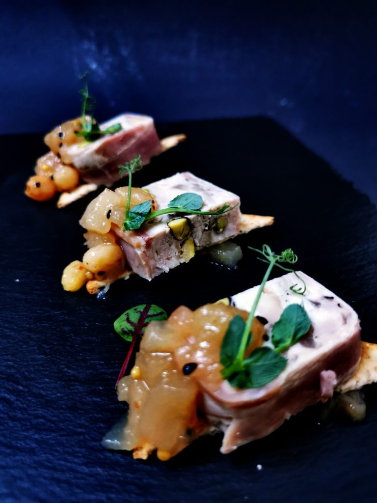 3. Rabbit terrine with pistachios, wrapped in premium bacon, pear chutney and whole mustard seeds on top of whole-grain crackers.