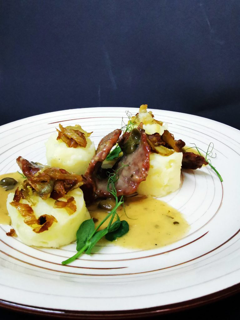 4. Beef scallops in piccata sauce with mashed potatoes and caramelized fennel.