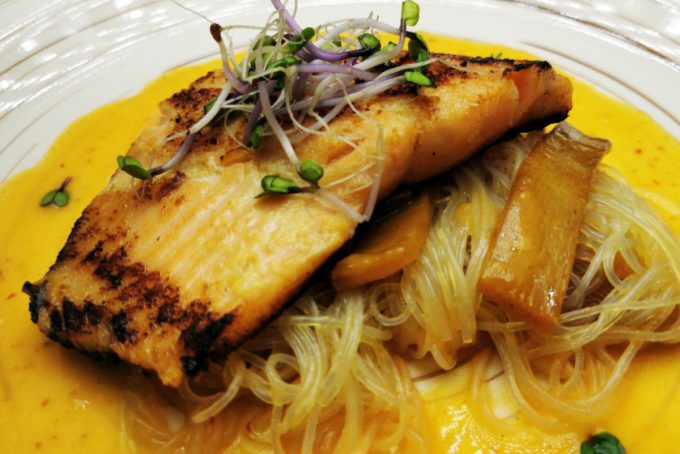 4. Glazed salmon trout fillet on rice noodles with stewed bamboo and red curry velote.